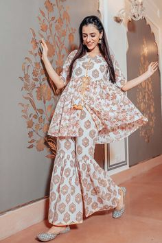 Shop online Orange cotton sharara set - set of two Hand block printed co-ord set with tie up detailing along the waistline Fancy Dress Design, Stylish Dress Designs, Designs For Dresses, Gharara Designs, Kurti Designs Party Wear, Dress Indian Style, Indian Fashion Dresses, Stylish Dresses For Girls, Casual Dresses