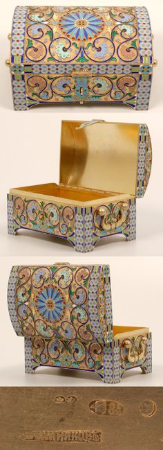 A Russian silver gilt and cloisonne enamel casket, Pavel Ovchinnikov, Moscow, circa 1908-1917. The rectangular trunk-shape box on four bracket feet enameled in multi-color scrolling foliate motifs, the domed cover centered with a radiating blue and turquoise roundel interspersed with red enamel beads against a stippled glided ground, wide double circle motif borders.