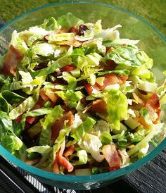Brussels Sprouts, Bacon, Dried Cranberries, Almonds, Green Apples, and a delicious paleo dressing!