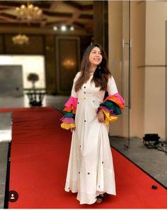 Bell sleeves creme gown - RJ Megha in Karishma Hingorani - Kzari Salwar Designs, Kurti Neck Designs, Dress Neck Designs, Kurti Designs Party Wear, Designs For Dresses, Blouse Designs, Pakistani Dresses, Indian Dresses, Indian Outfits