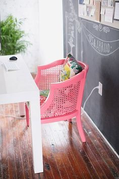 My mom and dad had one of these chairs and I hated it! Thought it was so ugly!! However I see it in pink with some pretty seat fabric and I actually love it now! Again proves my saying that paint can change anything. Plus what a great chalkboard wall.