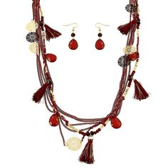 "Health, love and prosperity to you while wearing our Cora necklace. Vibrantly layered and beautifully pulled together, she's filled with beads, tassels, and shimmering accents.   Comes with crystal drop earrings  Multi Chain Length 30"" + 2""ext   Lead Compliant"