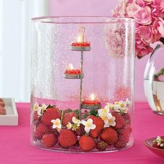 Grand Hurricane by PartyLite Candles, red tealights, strawberries, white flowers, pink tablecloth, centerpiece http://www.partylite.biz/legacy/sites/nikkihendrix/productcatalog?page=productdetail&sku=P91721S&categoryId=58466&showCrumbs=true