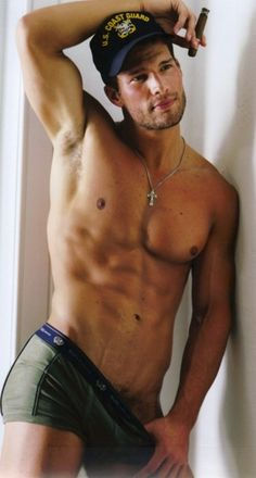 Aaron O'Connell. I wish he was standing like that, with his cigar, in my bedroom, waiting for me!!! (drool....)