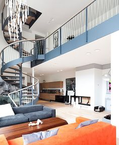 Elegant Home Interior In Post Modern Style : Stunning Circular Stair Design That Stand Out In The Living Room