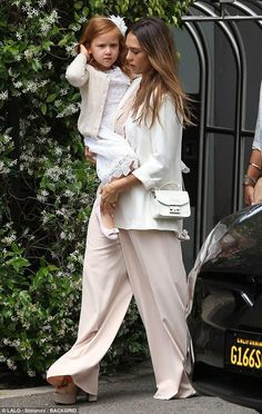 Jessica Alba wearing Saint Laurent Candy Leather Platform Sandals and Furla White Metropolis Crossbody Bag