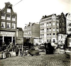 1940's. A view of the Waterlooplein. The Waterlooplein is a square in the center of Amsterdam, near the river Amstel. The square was created in 1882 when the Leprozengracht and Houtgracht canals were filled in. In 1893, when the city government decided that the Jewish merchants in the nearby Jodenbreestraat and Sint Antoniebreestraat had to move their stalls to the Waterlooplein, the market was established. The market is open every day except Sunday. #amsterdam #1940 #Waterlooplein