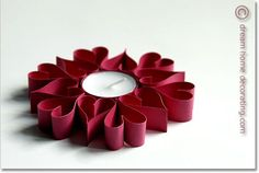Elegant touch for your Valentine's Day table: tea light holder made of paper hearts. It's much easier than it looks!
