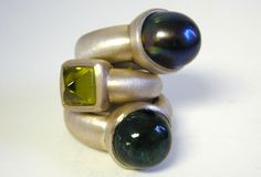 Sterling silver rings set with black pearl, peridot and tourmaline by Alex Schleicher (I wonder how much they are?) #rings
