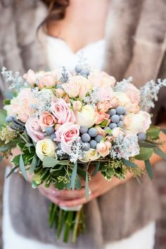 pastel bouquet of roses and hypericum berries