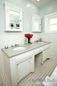A Blue And White Bathroom With A Pedestal Sink By One Week Bath