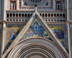 Orvieto Duomo_Mosaic over the central portal Mosaic on the central portal of the facade with the Assumption of Mary in Glory. Mosaics on Left and Right: the Apostles