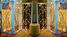 Create sections of space in a large or awkward space with beautiful twinkling room dividers. / 27 DIY Ways To Make Your Home So Much More Cozy