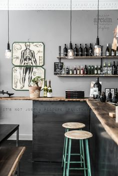 possible color scheme in shop...wood...black on lower half of store...glass accents...modern cool and clean but also masculine