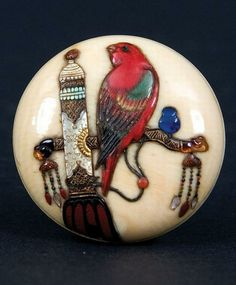 An ivory mid-19th century Shibayama Manju netsuke. A very fine and rare Shibayama inlaid manju netsuke, the details of a bird on an elaborate perch are in coral, shell, gilded horn and hardstones. Japan
