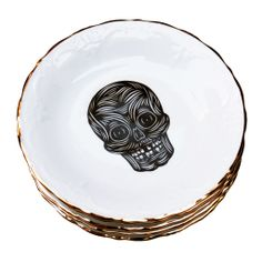 """Patch NYC's seven-inch porcelain skull plates finished with classic gold trim, give new meaning to """"bone china."""""""