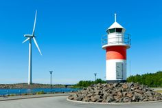 A wind turbine and a lighthouse in Reposaari, Finland.