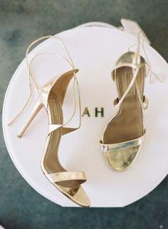 Strappy metallic gold shoes: http://www.stylemepretty.com/2016/02/08/chic-valentines-day-elopement-inspiration/   Photography: Caroline Tran - http://www.carolinetran.net/