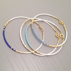 Everyday bracelet tiny gold bracelet gold bead bracelet Every day Jewelry - Schmuck Ideen - Bracelets Bracelet Friendship, Friendship Bracelets With Beads, Simple Bracelets, Stackable Bracelets, Layered Bracelets, Seed Bead Bracelets, Bracelet Set, Tassel Bracelet, Gold Bracelets