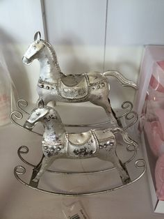 Different sized decorative rocking horses