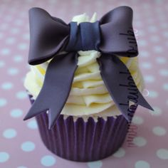 Purple bow cupcake.
