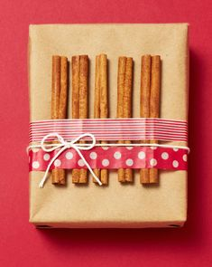 The perfect wrap for food gifts! Cinnamon sticks, washi tape and string. More ideas: http://www.midwestliving.com/holidays/christmas/easy-christmas-gift-wrap-ideas/?page=3