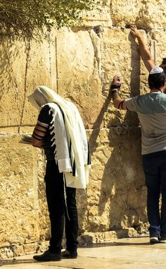 The hem of Yeshua's garment likely refers to the tzitzit now commonly found on the tallit (prayer shawl).