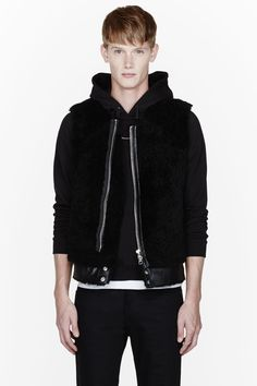 ACNE STUDIOS //  Black leather and Shearling Eliot vest  32129M031002  Boxy shearling vest in black. Crewneck collar. Off-center two-way zip closure at front. Zippered welt pockets also at front. Removable buffed leather waistband with press-stud closures. Tonal stitching. 100% lamb shearling. Dry clean. Imported.  $1450 CAD