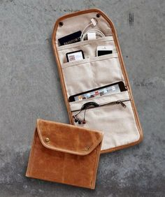 Gadget Carrier. This flip open zipped gadget case keep all your essentials well organized in style crafted in a supple leather and lined with soft cotton canvas. It's a perfect solution to keep all your devices. http://hative.com/ways-to-organize-your-familys-electronics/