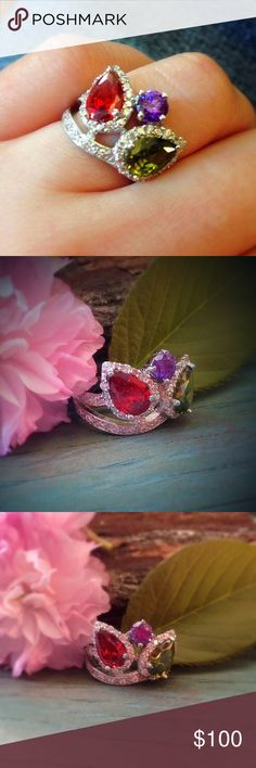 sterling silver amethyst, garnet, peridot cz ring A sparkling leafy design in sterling silver fill with gorgeous fiery cz stones in amethyst, peridot and ruby/garnet colors is a beautiful cocktail statement ring. Size 6 Jewelry Rings