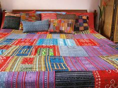Bohemian style bedding in a colorful patchwork of Hmong textiles. Snuggle up in beautiful comfort with this soft, vintage, embroidered, 100% cotton batik duvet cover. We have taken a vintage batik, applique and intricate embroidery blanket done by the talented Hmong women and turned it into a duvet cover. The duvet cover is backed with natural indigo cotton. **Free worldwide shipping**  Hmong embroidered and appliqued cotton batik Black 100% natural cotton backing Vintage hand drawn…