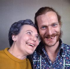 Ginger Baker, the Cream and Blind Faith drummer, flashes a rare smile with his mother Ruby Streatfield inside her rowhouse in Bexley, outside London, 1970
