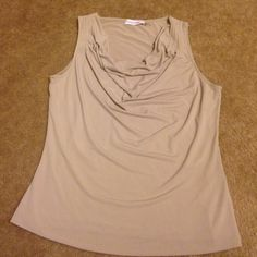 Beige color sleeveless shell Never worn, beautiful draping, just don't have anything to go with it Calvin Klein Tops Blouses