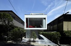 designed by japanese architect junichi sampei, 'denenchofu house' is sandwiched between two much larger dwellings in an affluent area of suburban toyko.