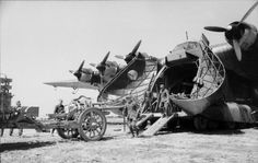"Loading a Messerschmitt Me 323 ""Gigant"" in Italy for transport to Tunisia, 1943."