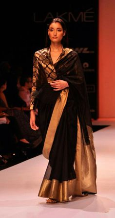Black and gold saree and long sleeve blouse