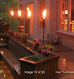Tiki torch in planters - why didn't I think of that!