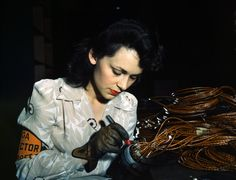 Woman aircraft worker, Vega Aircraft Corporation, Burbank, Calif. Shown checking electrical assemblies, June 1942. Photographed by David Bransby for the Farm Security Administration.