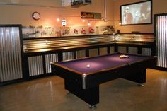 This a pretty cool idea - to combine your garage with your own 'man cave' - pool table, beer fridge, TV...