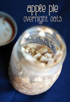 Nearly top-down image of a mason jar filled with chunky oatmeal, with lots of visible little apple pieces.