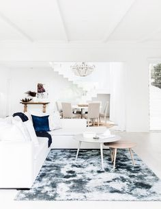 Modern coastal living room by Three Birds Renovations.