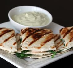 Chicken, spinach, goat cheese quesadillas with avocado sour cream...reminds me of @Stephanie Halperin
