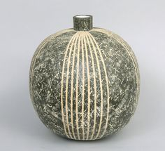 "Claude Conover (American, 1907-1994) ""Kaknub"". Glazed ceramic vessel, probably ca. 1970's, signed and titled on bottom, . 18""T x 15""W. Cross hatched incised surface with vertical banding. Matte finish in dark finish with slip rubbed in to heighten the patterning."