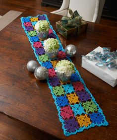 Holiday Party Table Runner Crochet Pattern  Crochet a table runner that will set the stage for festive holiday gatherings. We've shown it using six shades of sparkly yarn, but it would work well in whatever colors you use for decorating.