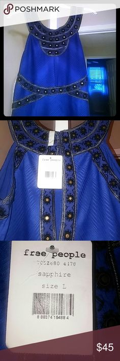 Free People Sapphire dress NWT large junior cut This dress is simply gorgeous with black trimmed gold accents around the bodice, arms & neckline. Will fit a bustier women up to a 38D but it goes into a A line so your waist & hips should be trim for it to lay right. It fit me but very snug, I'm curvy. The back is cute out & the arms are curved in. This is perfect for a wedding or special occassion with black pumps or ankle strap sandals. And the color is to simply die for, so pretty💗💕 Grab…