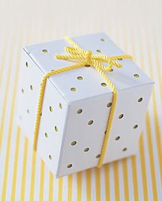 Provide a punch of color on a favor display with these polka-dot gift boxes.