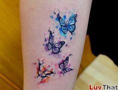 blue_purple_pink_orange_butterflies_tattoo.jpg 800×611 pixels