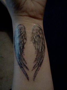 Wing, wrist tattoo on TattooChief.com
