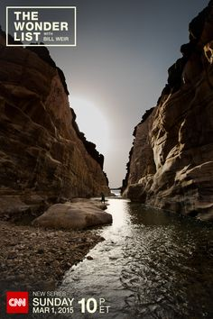 Bill Weir walks along the streams of the Wadi Mujib canyon during a trip to the Dead Sea for his new show The Wonder List with Bill Weir– Sundays at 10pm ET on CNN, starting March 1, 2015. (Photo by Philip Bloom)