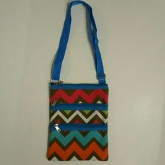 CROSSBODY CHEVRON BRIGHT 3 COMPARTMENT BAG NWOT!!! PERFECT FOR A THEME PARK, THE GIRL ON THE GO! MULTI COLOR CHEVRON PRINT, CROSSBODY, ADJUSTABLE STRAP 3 ZIPPER COMPARTMENT BAG MAGENTA,GREEN,WHITE,BLUE,BROWN,&ORANGE  NWOT NEW WITHOUT TAG! Bought, and FORGOT For My Vacation At Busch Gardens=( Stored In the New Suitcase I Forgot About!  Great Bundle Item!  No Smoking, Buy It Now, Ask Questions, Make A Reasonable Offer, Bundle Discounts, Price Drops Available For Possible Shipping Discount, NO…